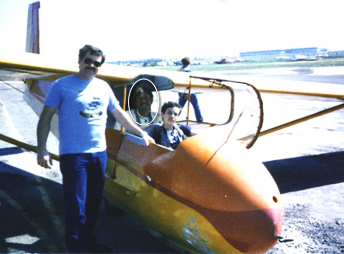 Jim Riordan, Bret Willat and Brett Riordan standing by a Schweitzer 233 Sailplane