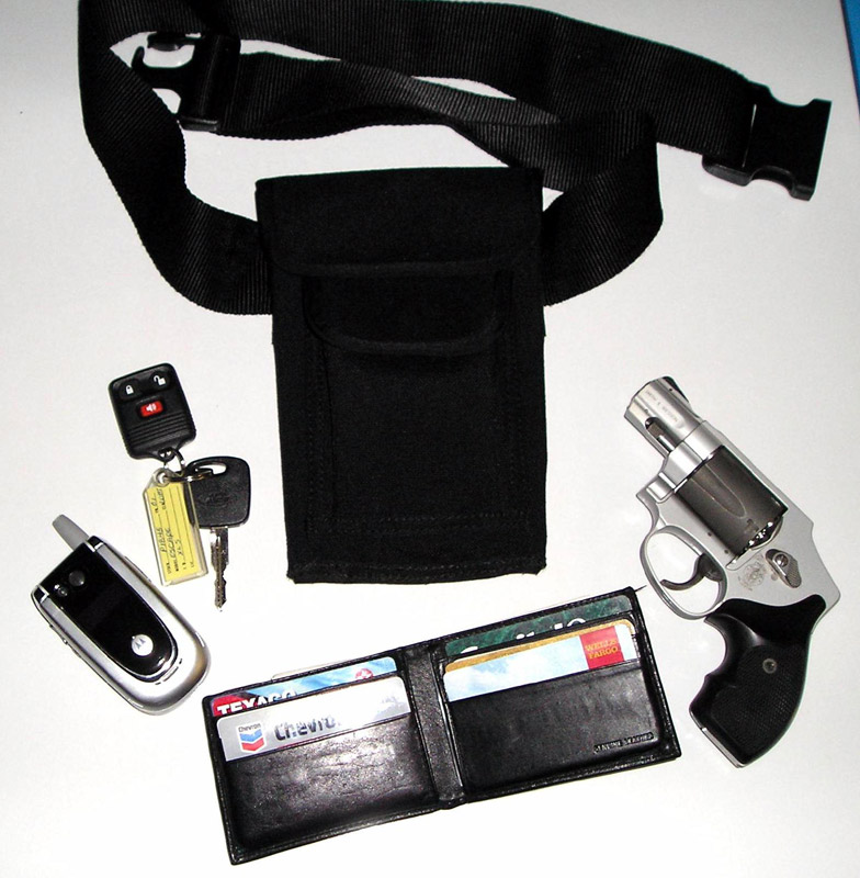 Holdstar with wallet, keys, cell phone and gun