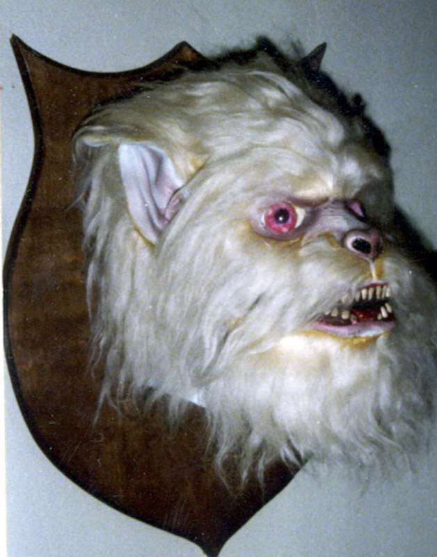 "Head clock with face of abominable snowman or ""Yetty"", with mouth closed"