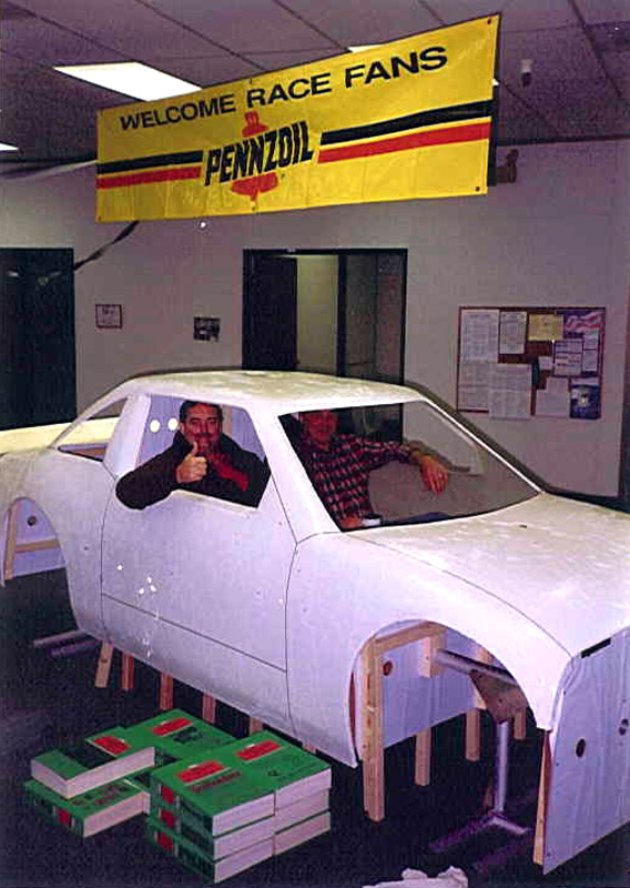 Jim with Rick Moncrief sitting inside first molded body