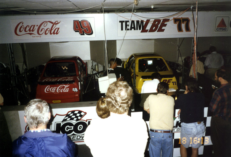 People waiting in line to drive the finished NASCAR car simulators