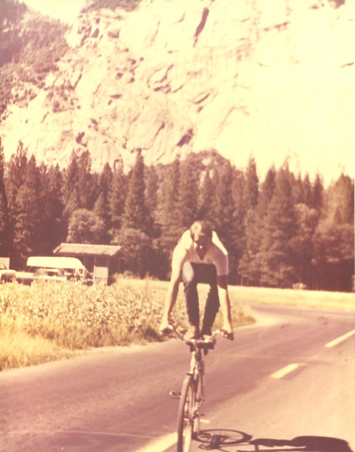 Jim Riordan Standing on bicycle seat in Yosemite